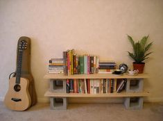 super easy diy bookshelves . . would be nicer looking w/ dark stained wood & more shelves