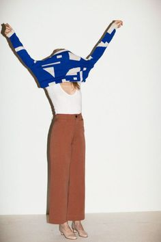Nikisha Brunson - minimalist fashion inspiration - wide trousers - Brown white blue color palette