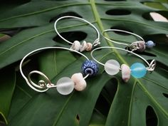 Silver Wire Wrapped Puka Shell Bangles Assorted by RaymiKUDamo, $22.00