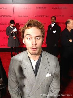Sam Claflin hamming it up at the premiere of The Hunger Games: Catching Fire at the Nokia Theatre in Los Angeles, CA on Hunger Games Humor, Hunger Games Catching Fire, Hunger Games Trilogy, Sams C, Suzanne Collins, Sam Claflin, Mockingjay, Jennifer Lawrence, Actors & Actresses