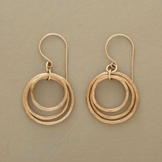 """CIRCLE OF THREE EARRINGS--In these three-circle hoop earrings, glimmering 14kt gold-filled rings go 'round and 'round in a trio of hoops that dance and sway harmoniously. Handmade in USA. Exclusive. 1-1/2""""L."""