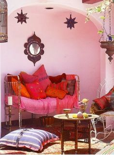 Love the pale pink in the wall. It looks like the brighter colors are reflecting back to a white wall.