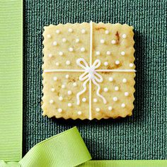 Day Seventeen: A drizzle of pineapple icing adds flavor and a festive look to this simple shortbread #cookie recipe. A buttery-rich addition to any #Christmas cookie tray. #25DaysOfChristmasCookies