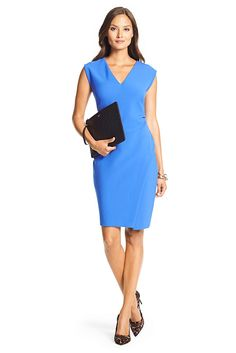 The Megan is a new wear to work favorite. With a clean v-neck, flattering cap sleeves and ruching detail, and an asymetrical slit that adds movement and intrigue to this staple sheath dress. Falls to above the knee. Fit is true to size.