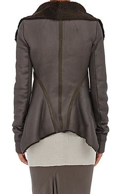 """Rick Owens Naska Shearling Biker Jacket $3,865, constructed in panels of dark grey washed leather lined with shearling and finished with smooth leather-taped seams. Panel construction. Convertible funnel neck. Rib-knit panels under sleeves. Contoured seaming at back. Handkerchief hem.     24"""" center back length (approximately).     Asymmetric zip-front closure."""