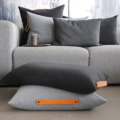 grey sofa and cushions with leather handles