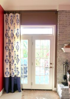 "the curtains were made from a drop cloth (88"" length) and a stencil, then she added navy curtains to make them longer so she could hang them high."