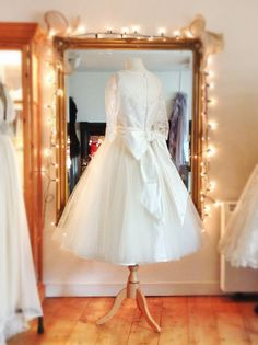 Silk tulle and lace full-skirted tea-length wedding dress with oversize bow, by www.joanneflemingdesign.com