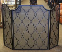 Black folding fireplace screen with geometric design by Uttermost. #OnTheShowroomFloor #Black #Folding #Screen #Geometric #Uttermost #Designer #StillGoode