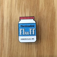 Fluff. Born in Somerville, Massachusetts, enjoyed world-wide, obsessed upon in the Northeast. If you don't know how to make a Fluffer-Nutter, this pin doesn't belong on your lapel. Product Details - 1