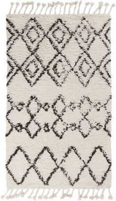 This textured moroccan rug with a simple pattern design with freshen up your floor space. Dress it up with a cozy throw and vintage textile pillows.