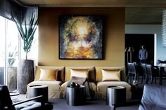 Grounded glamour, with its mineral-toned palette and luxury finished, designer Paul van den Berg's apartment on the slopes of Cape Town's signal Hill articulates an intriguing idiom of earthy opulence. South African Homes, South African Design, Open Layout, Interior Decorating, Interior Design, Living Area, Living Rooms, Apartment Design, Decoration