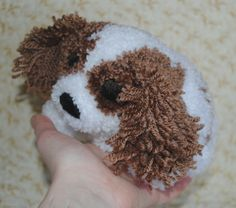 Knitted puppy soft toy.
