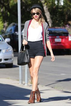 -cute black hat, black sunglasses, gray cardigan, white v-neck T-shirt, black purse, black high waisted shorts, brown booties spring/summer Taylor Swift outfit-