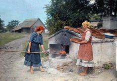 June Hungary --- Two peasant women bake bread with an old-fashioned stove --- Image by © Hans Hildenbrand/National Geographic Society/Corbis Half The Sky, National Geographic Society, Vintage Farm, Fine Art Photo, The Good Old Days, Vintage Images, Vintage Pictures, World War I, Polar Bear