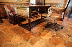 These log end floors are nothing less than amazing. Check out the gradation and age on those log slices. Custom-made, they are the epitome of natural wood flooring. Winner of the Northwest Forestry Association's Environmental Craftsmanship Award