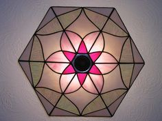 Tiffany style stained glass uplighter currently hanging in my hallway.