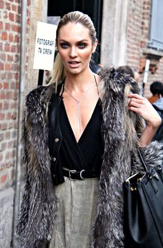 Queen of Dark: smokey eyes, black deep V-neck top, leather blazer layered over with furr jacket, high waist animal printed bottoms, high heels and pitch black pursue  Spring 2014
