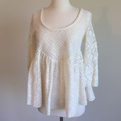 Free People top Excellent condition. Beautiful ivory color. Very soft. No signs of wear at all. 3/4 sleeves. Free People Tops