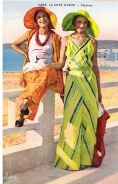 Colorized early 30s postcard of fashionable beach-pyjama-wearing holiday-ers on the Cote D'Azure