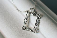 I love this picture frame necklace from etsy