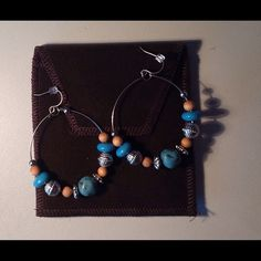 Artist made earrings with gift box 📦 Beautiful! This are beautiful artist made earrings. They have never been worn. They are 2 inches by 2 inches. They come complete with pouch and gift box. NWOT Jewelry Earrings