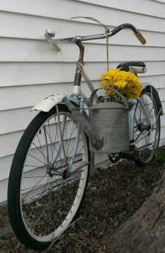 Antique Firestone Pilot bicycle with hanging watering can. Photo by OldHouseChic.