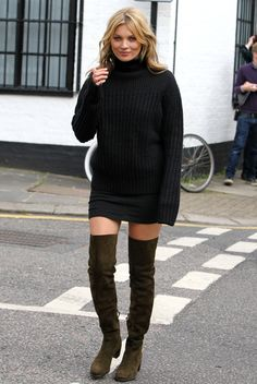 The thigh's the limit for Kate Moss as she was spotted wandering the streets of London on a Stuart Weizman boots shoot