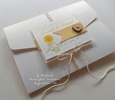 Sunflower pocket wallet wedding invitation - with wooden button and twine fastening.    Handmade in the UK by Birchwood Handcrafted Invitations.