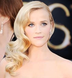 "Reese Witherspoon sported Veronica Lake-esque waves, which were made modern with brushed out, loose curls instead of stiff coils. ""It's pure beauty and glamour and just perfect for a special occasion"
