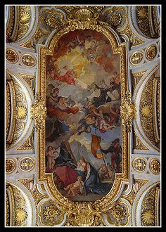 The frescoes on the ceiling depicting St Louis were painted in 1756 by Charles Joseph Natoire, famous for his paintings at Versailles