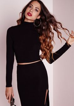 Get your fashion fix this weekend in this off the hook black crop top. In figure flattering ribbed fabric this top is seriously killer. With high neck and long sleeve details this crop is so on point right now. Team up with the matching co ...