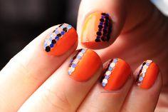 Orange and blue glittery nails