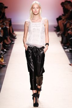Isabel Marant | Spring 2014 Ready-to-Wear Collection | Style.comtop with ruffle and side laced leather pants