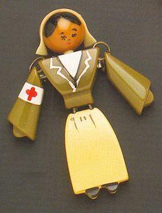 Nurse brooch of Bakelite