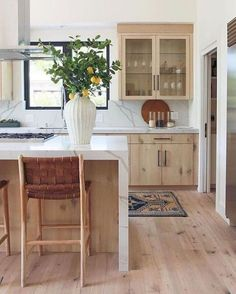 Wood cabinet kitchen with wood floors and marble counter tops with waterfall counter on island. Lemon branches to add a splash of color Wood Floor Kitchen, New Kitchen Cabinets, Built In Cabinets, Kitchen Dining, Kitchen Decor, Floors Kitchen, Kitchen Island, Rustic Kitchen, Country Kitchen