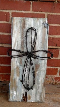 Old Barb Wire Cross On Painted Old Barn Wood