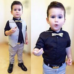 Perfect little boy outfit.black shirt,gold bow,grey west and pants black shoes and belt. Toddler Boy Fashion, Little Boy Fashion, Toddler Boys, Kids Boys, Fashion Kids, Little Boy Outfits, Toddler Outfits, Baby Boy Outfits, Toddler Wedding Outfit Boy