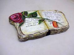 como pintar piedras con un libro y una rosa - Pedreta de Riu