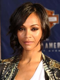 The Sidewinder Zoe Saldana's low, side bun is a must-try. (More than one hairstylist has confirmed that it's the popular updo right now.) When you create this look at home, start with loose curls; then, pin them into a not-too-perfect knot covering one ear.