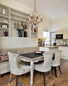 banquette for the kitchen, with a legged table, rather than a pedestal table