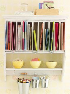Cute idea! Use a plate rack to store supplies.
