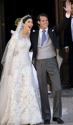 Just married: Claire Lademacher and Prince Felix of Luxembourg wave to the crowds at the Basilique Sainte Marie-Madeleine in Saint-Maximin-L...