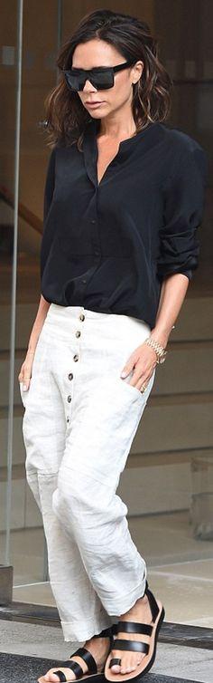 Victoria Beckham: Shirt, pants, and sunglasses – Victoria Beckham Collection Watch – Rolex Shoes – Celine