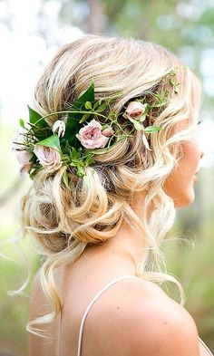 Hairstyle With Flowers And Some Fresh Leaves