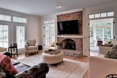 We just love a good exposed brick mantel, don't you? | 100 Greens Way, Williamsburg, VA, United States Luxury Real Estate Property - CB Global Luxury