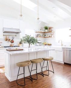 love the stools + light fixtures