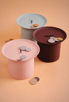 The Filter Storage Box Series functions as a coin bank and a dish to hold small items like keys. The dish on top of the container allows users to put small items for easy access while the coin bank below stores loose change.