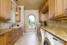 With flat-front cabinets, I could love this laundry room.  Love the natural light in a room that usually gets very little sun.