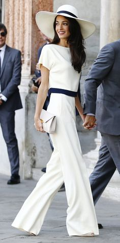 Amal Alamuddin wrapped up their wedding festivities with a civil ceremony at Venice's Municipal Building in a chic ivory-and-navy top. #InStyle